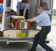 stretcher being taken off ambulance