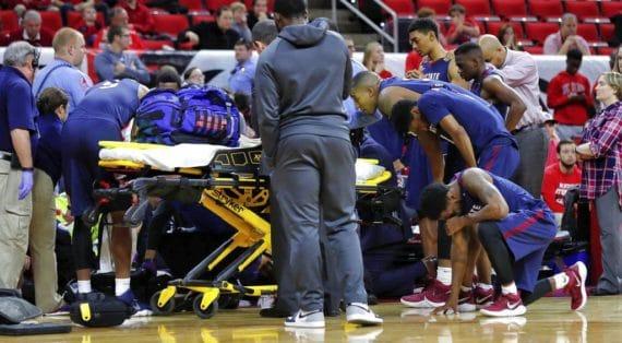 basketball player being taken away on stretcher