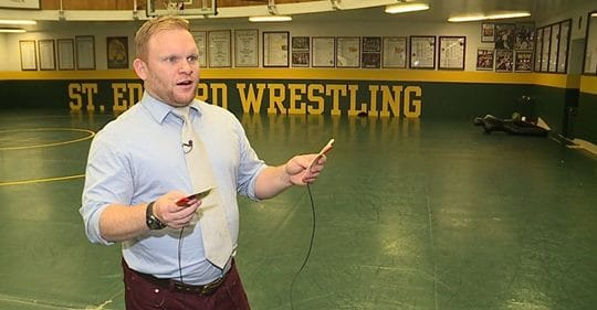 man with aed pads in wrestling room