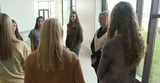 students meeting in school hallway