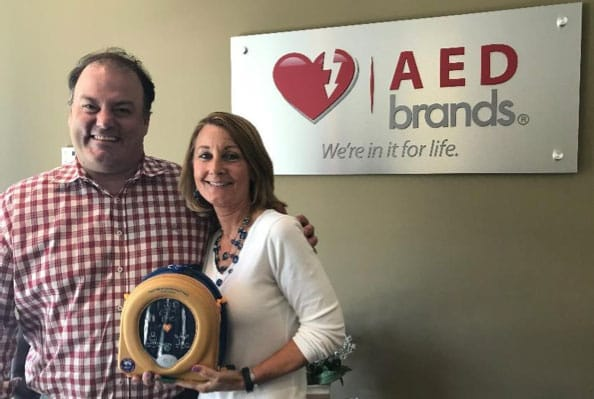 man and woman with AED