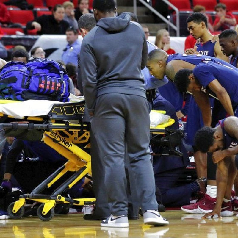 basketball player being taken away on stretcher